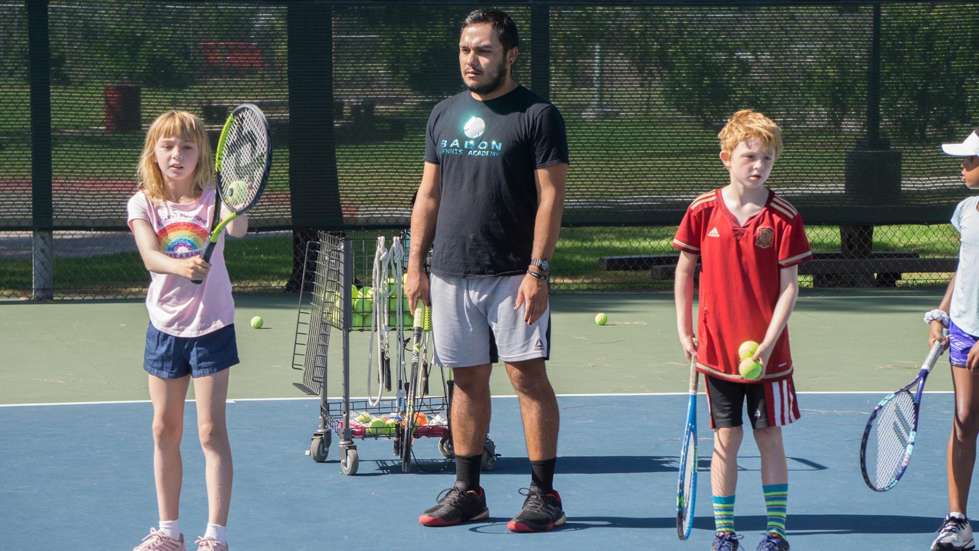 Gerald Sawyer teaches tennis on court