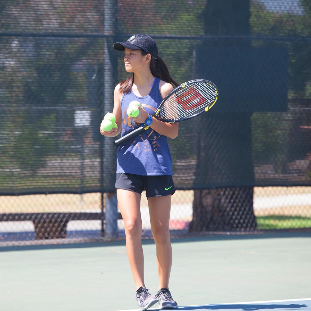 Junior Teen tennis player on court