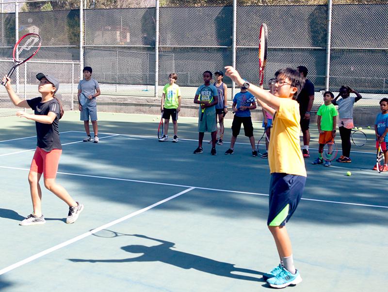 kids taking tennis class on Loma Alta court