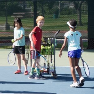 Kids learning tennis on courts Badon Tennis Academy